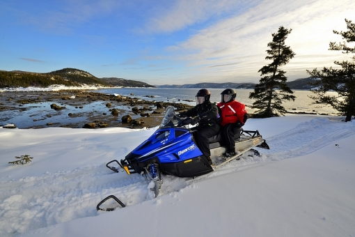 Guided snowmobiling on the Saguenay Fjord