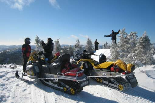 snowmobile and log cabine