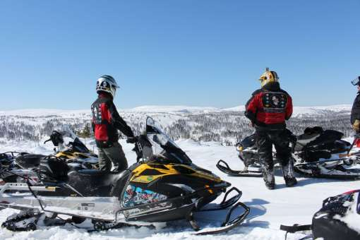 Half or full day snowmobile guided tour